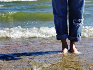 Barefeet standing on a beach
